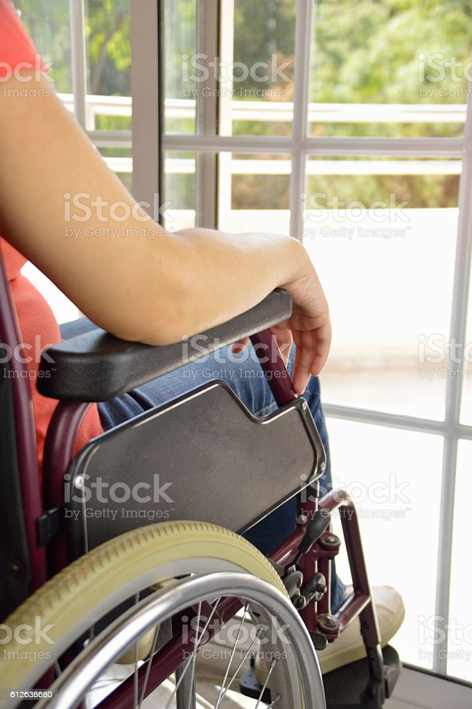 wheelchair at a home stock photo