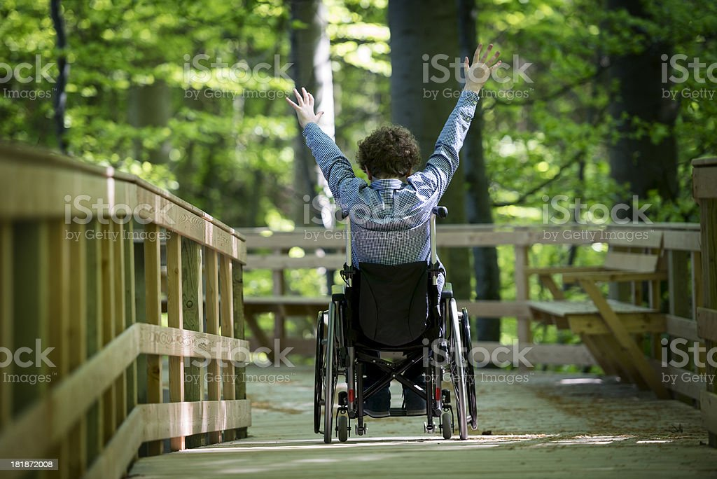 Wheelchair Bound Boy  Enjoying a Purpose Built Wheelchair Walkway stock photo