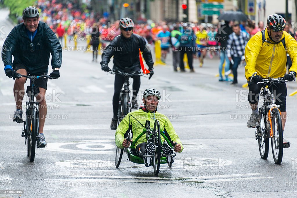 Wheelchair competitor in Madrid Marathon under heavy rain stock photo