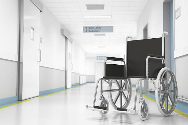 Wheelchair In Hospital Hallway Stock Photo