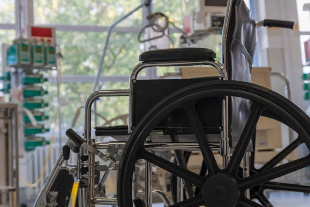Wheelchair in intensive care unit in hospital,  a place where can be treated patients with pneumonia caused by coronavirus covid 19. stock photo