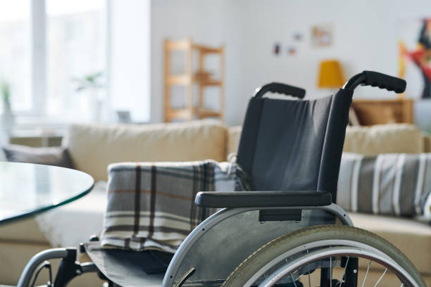 Wheelchair in living-room stock photo