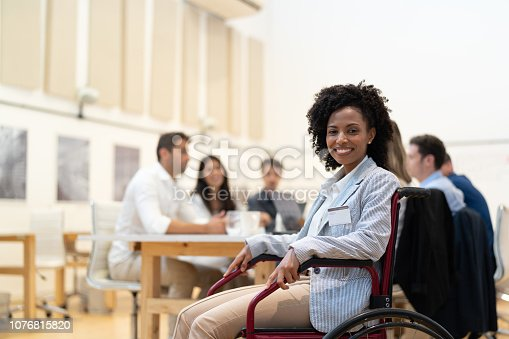 istock Wheelchair Leadership Businesswoman Portrait at Business Meeting 1076815820