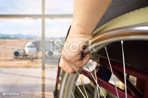 istock wheelchair man at airport 907137518