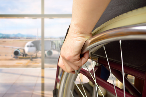 istock wheelchair man at airport 907137518