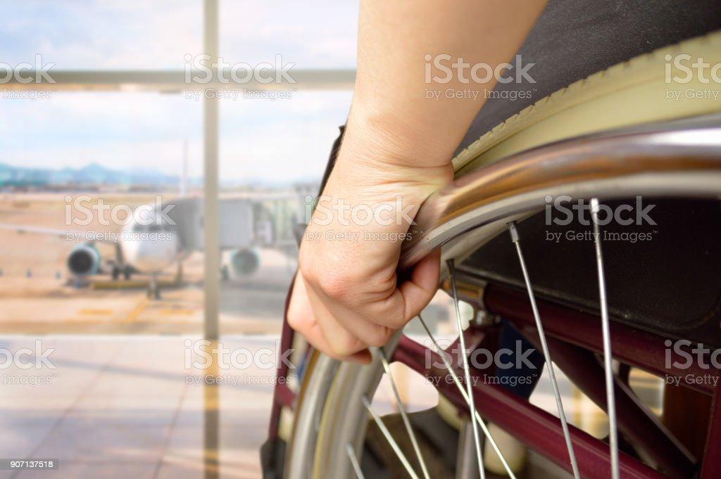 wheelchair man at airport stock photo