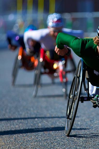 wheelchair race - wheelchair sports stock photos and pictures