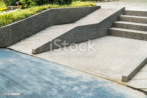 666724598 istock photo Ramp for the wheelchair and stairs for normal people adjoining. 1216188666