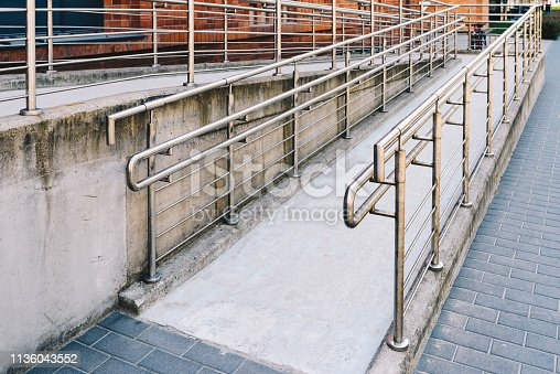 666724598 istock photo wheelchair ramp for disabled people 1136043552