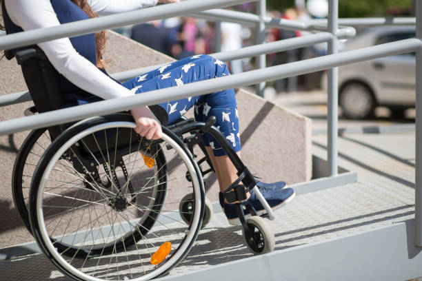 wheelchair ramp help for a young woman - aids healthcare foundation foto e immagini stock
