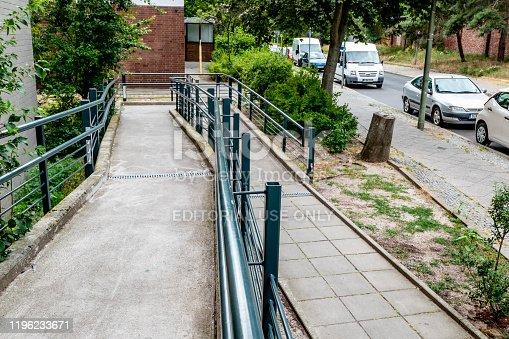 666724598 istock photo Wheelchair ramp residential building 1196233671