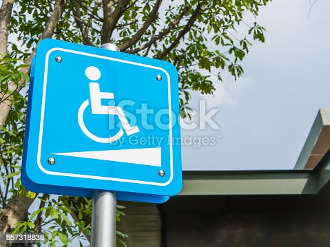 istock Wheelchair symbol in a parking lot. 857318838
