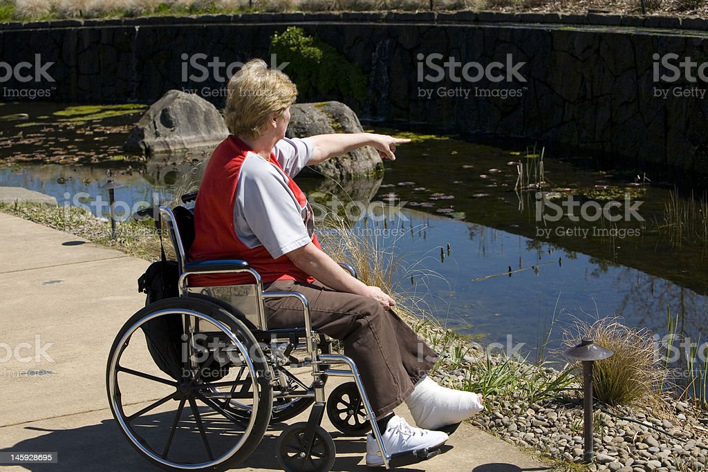 wheelchair time at the park stock photo