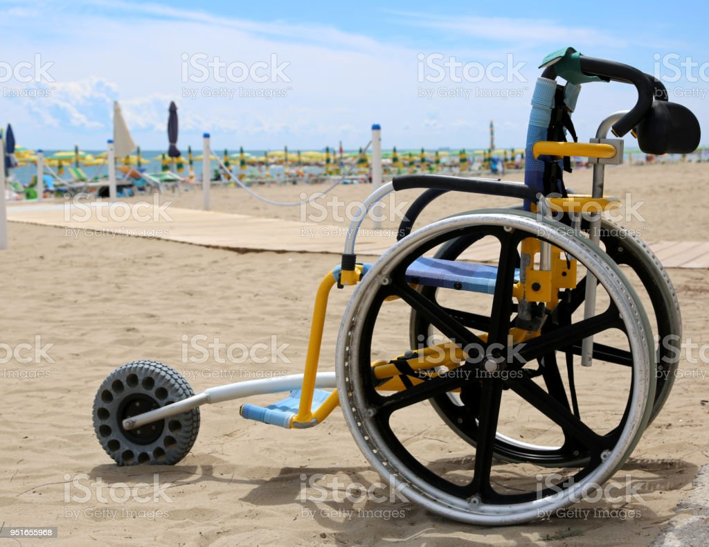 wheelchair with aluminum alloy wheels to move on the beach stock photo