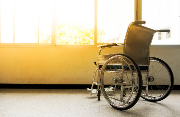 wheelchairs waiting for patient services. - wheelchair stock photos and pictures