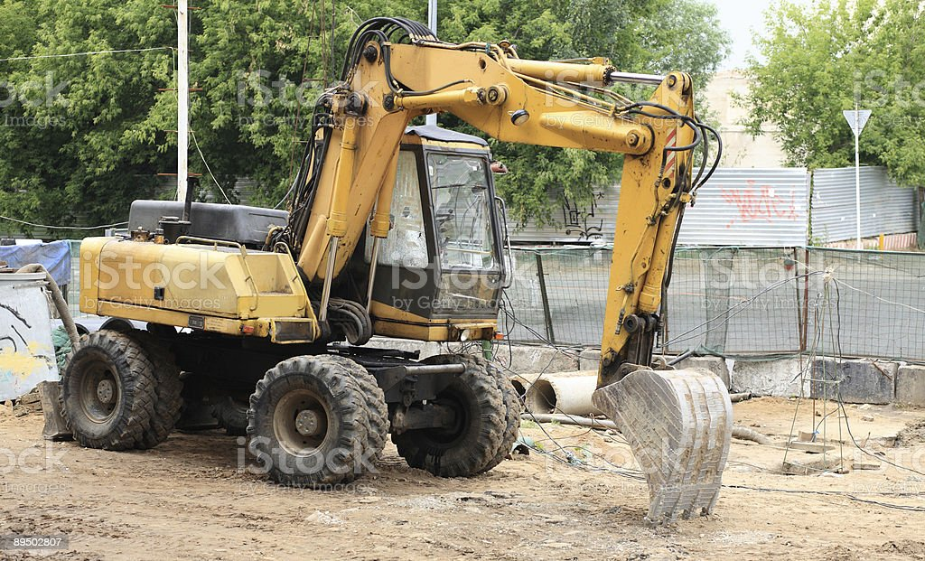 wheeled excavator on ground stock photo