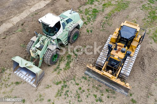 Two heavy duty construction vehicles viewed from above.