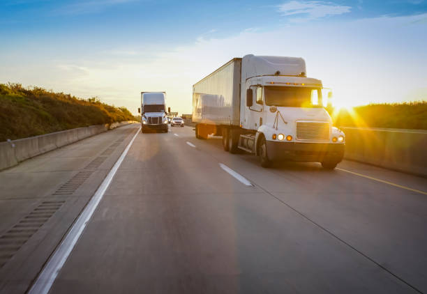 18 wheeler trucks on the road - highway stock photos and pictures