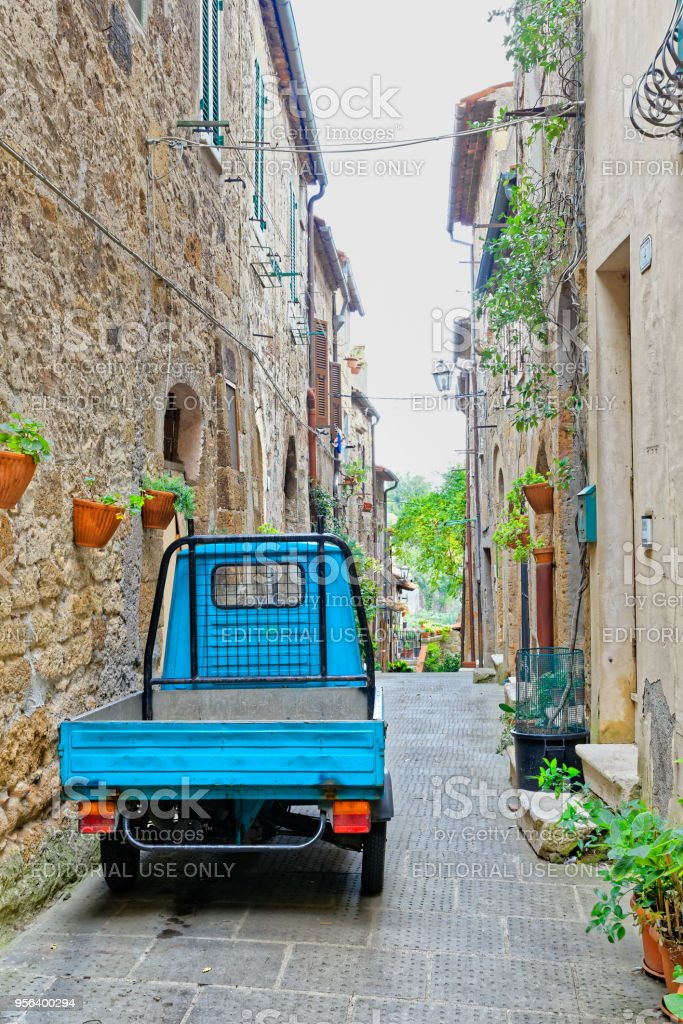 Wheeler work in an alley in Pitigliano, ancient village in Tuscany stock photo