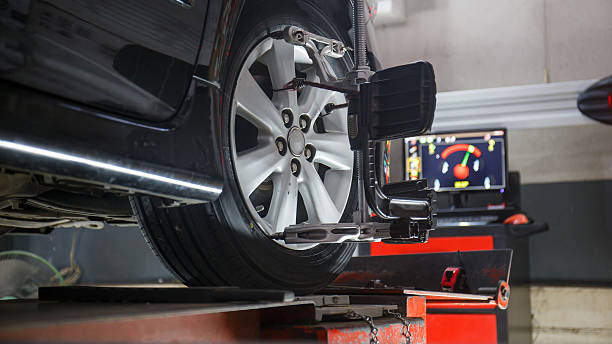 wheels alignment camber Car on stand with sensors on wheels for wheels alignment camber check in workshop of Service station. order stock pictures, royalty-free photos & images