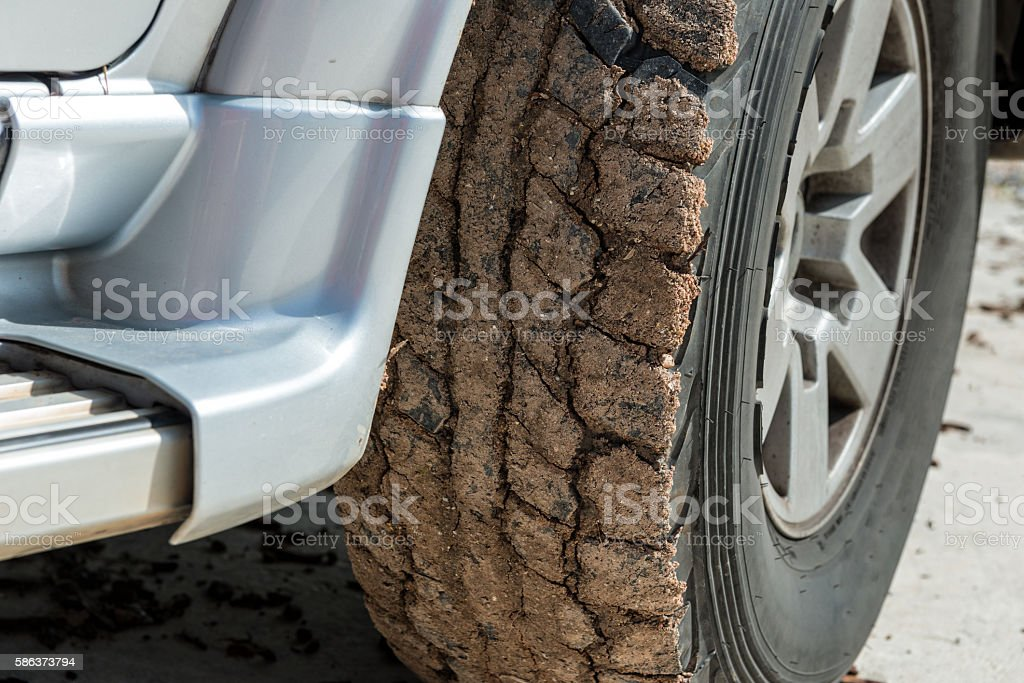 Wheels closeup in dry mud, off-road stock photo