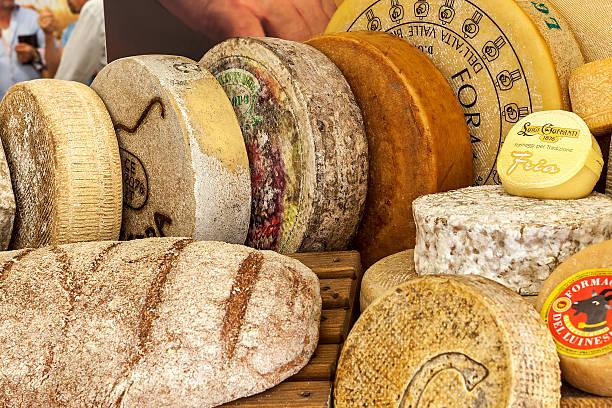 Wheels of hard cheese. stock photo
