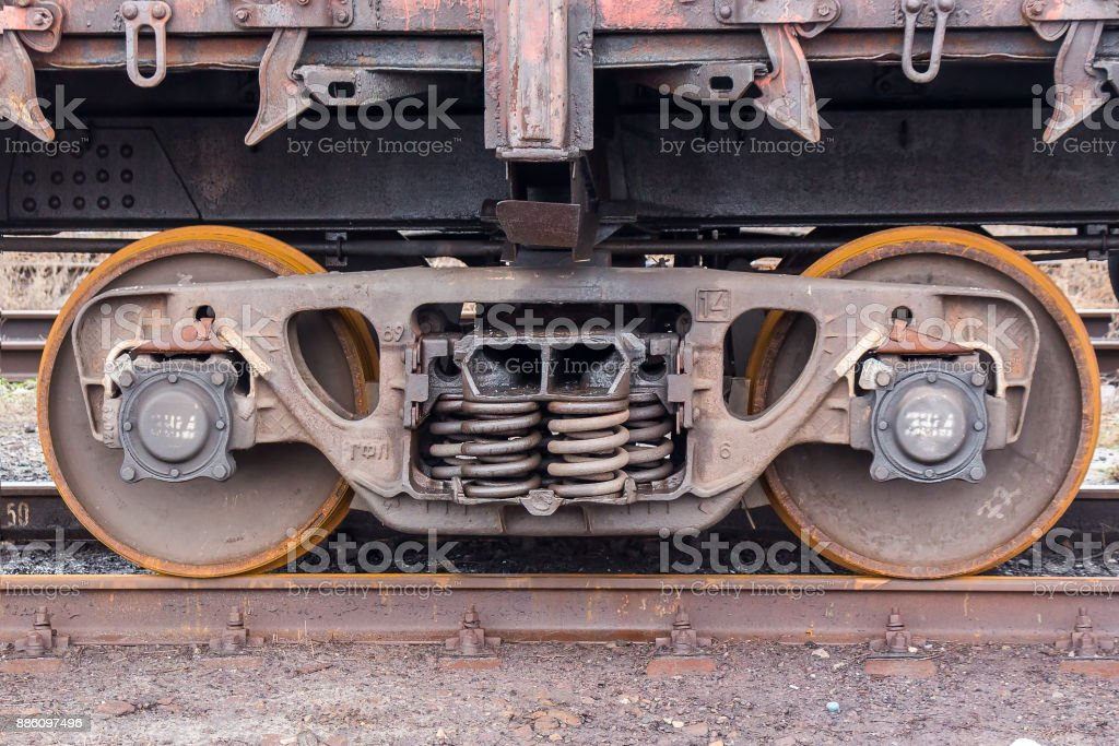 Wheelset of a freight car on the street stock photo