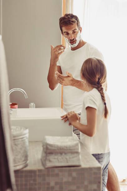 Girls shaving each other