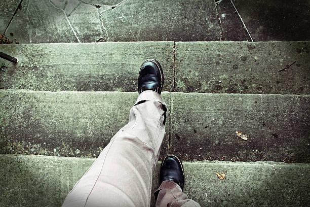 when climbing stairs vertigo - old man feet stock photos and pictures