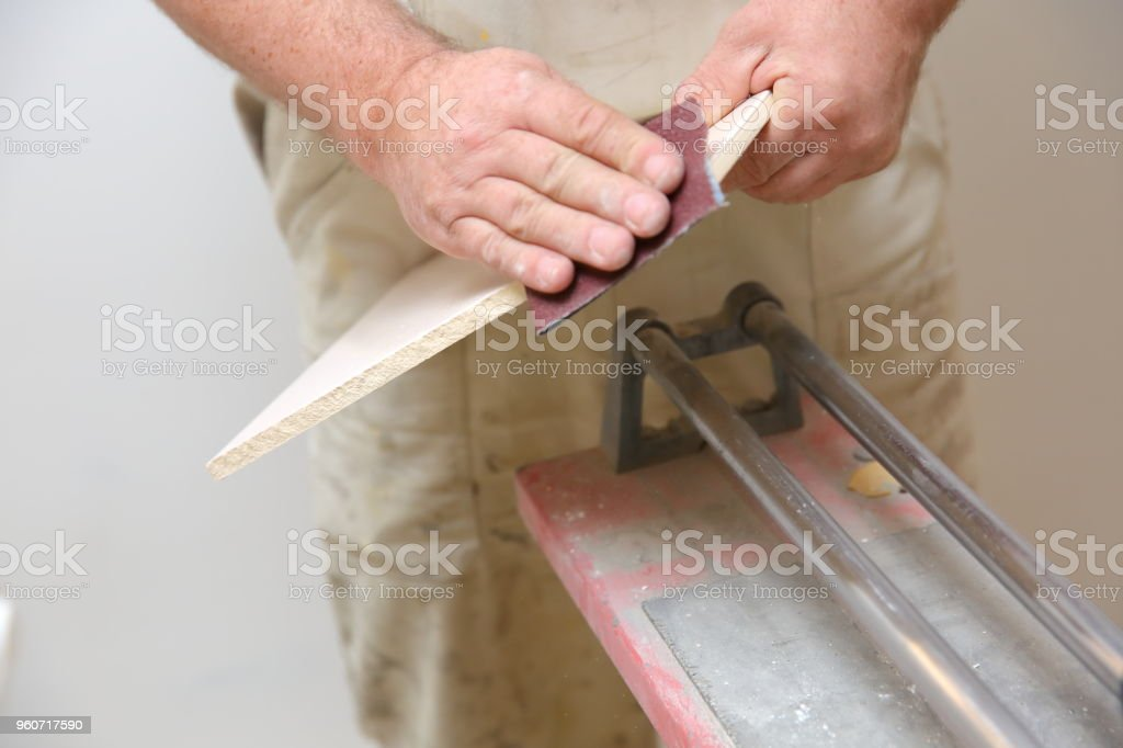 When laying ceramic tiles, you must also be able to use electrical devices such as a grinder and manual tools for cutting tiles. stock photo