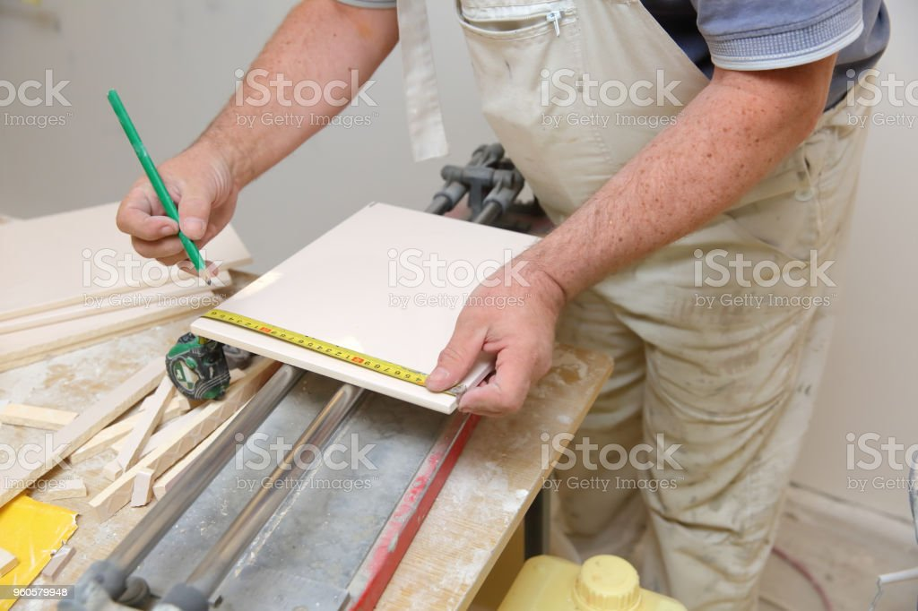 When laying the tiles, you need high accuracy and a lot of experience so that the final effect dazzles everyone who will use the bathroom. stock photo