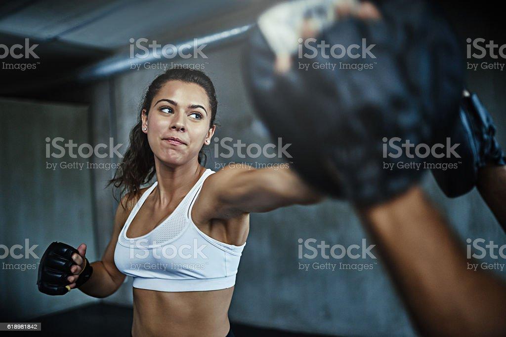 When life hits hard, she hits harder stock photo