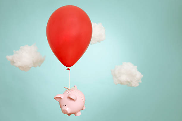 When piggy banks fly stock photo
