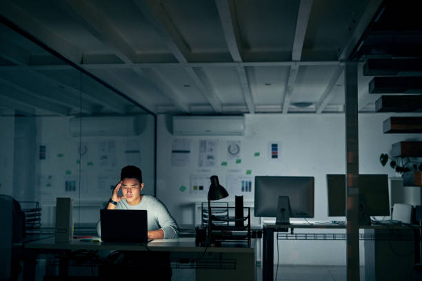 When stress starts to creep in Shot of a young businessman looking stressed during a late night in a modern office mental burnout stock pictures, royalty-free photos & images
