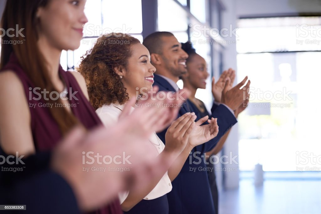 When the team hits a homerun, everyone cheers stock photo
