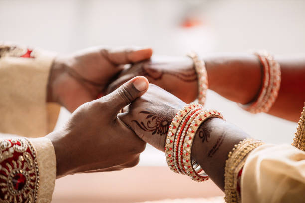 When two hearts became one Cropped shot of an unrecognizable young couple holding hands on their wedding day romance stock pictures, royalty-free photos & images