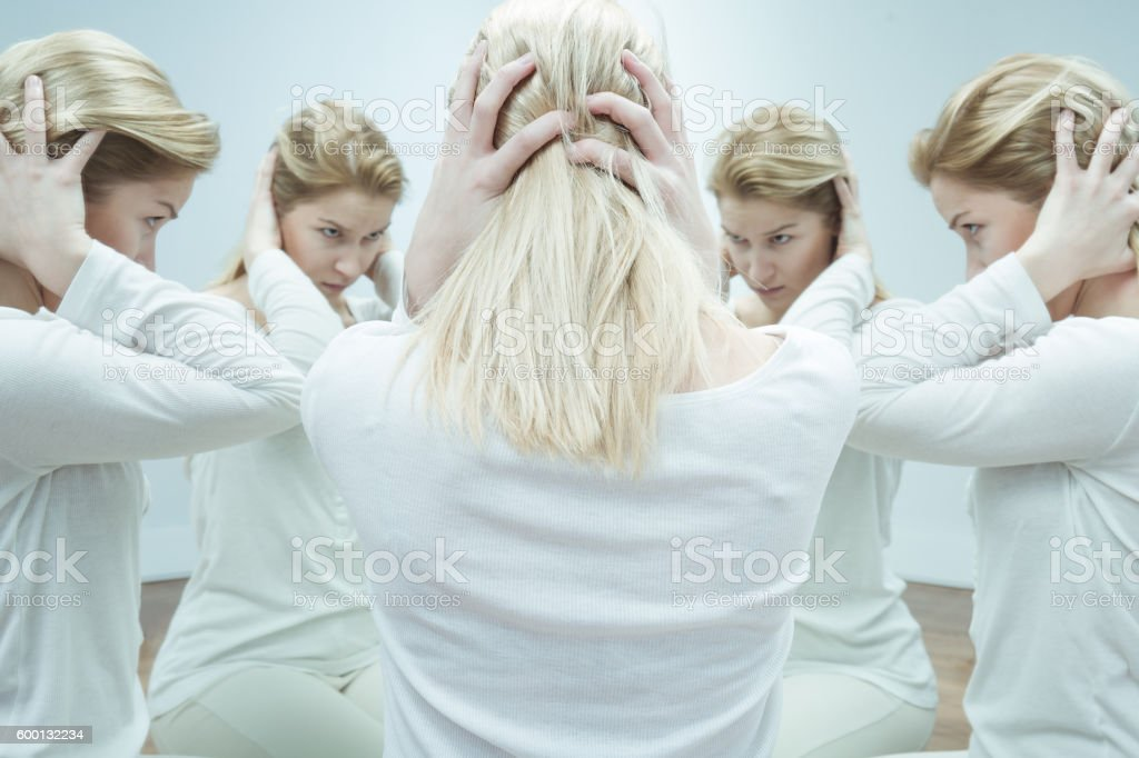 When voices in her head take control stock photo