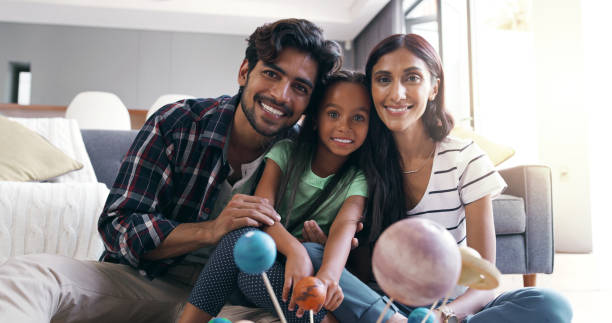 When we have each other, we have everything Portrait of a young family at home indian family stock pictures, royalty-free photos & images