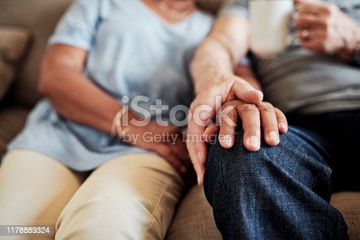 Cropped shot of an affectionate senior couple relaxing together on the sofa at home