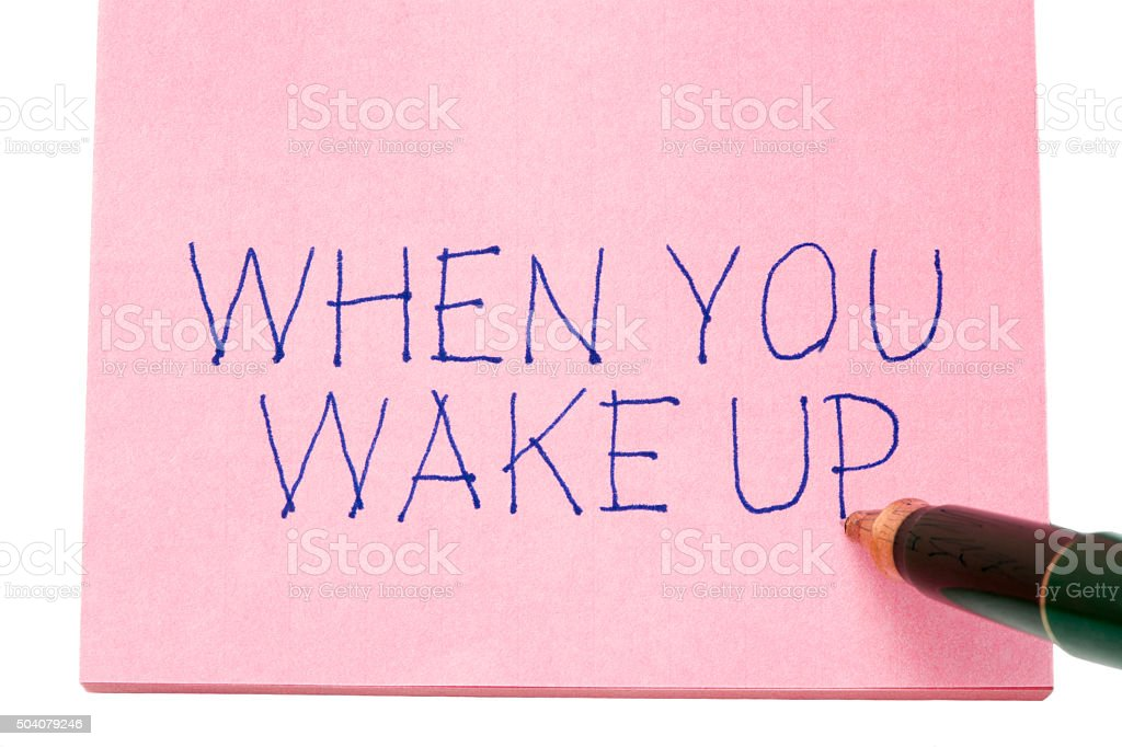 When you wake up written on remember note stock photo