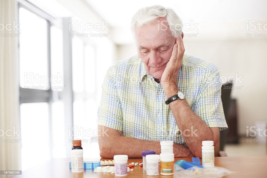 Where do I start with all these tablets? stock photo