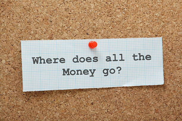 where does all the money go? - geld uitgeven stockfoto's en -beelden