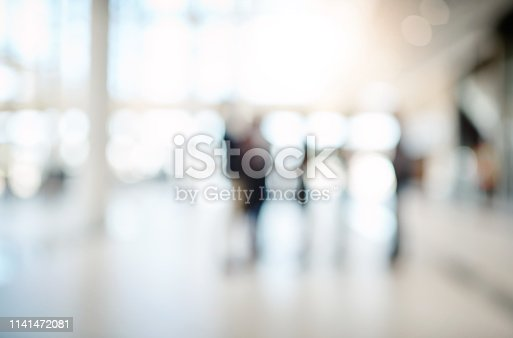 Blurred shot of a group of businesspeople attending a conference