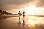 Shot of a happy senior couple going for a walk on the beach