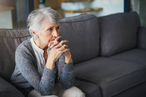 Where to from here? Shot of a senior woman suffering from stress at home mourning stock pictures, royalty-free photos & images