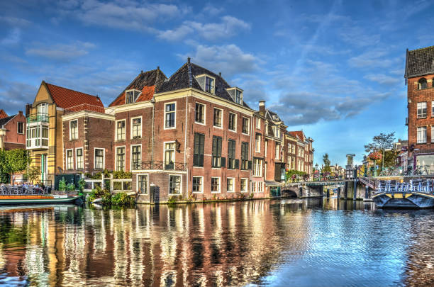Where two Rhines meet Leiden, The Netherlands,September 28, 2015: The location in the old city where the Old and New Rhine meet and continue as Silent Rhine leiden stock pictures, royalty-free photos & images