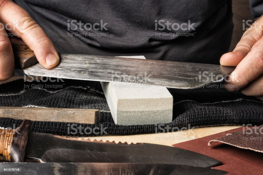 Whetstone which sharpen the knife. stock photo