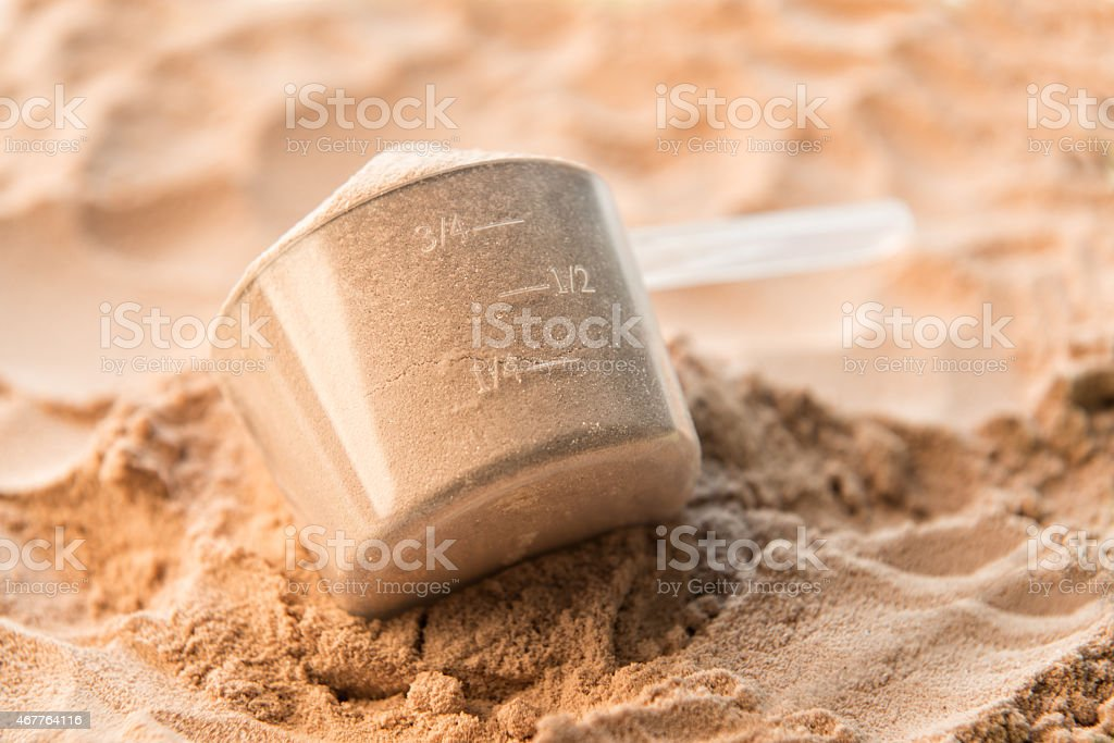 Whey protein scoop used for sports nutrition stock photo