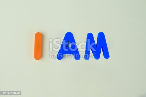 153276876 istock photo I AM which is written in different colored letter blocks on an isolated white background 1214299473
