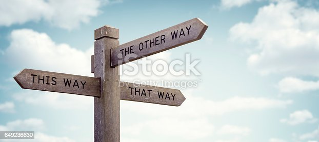 istock Which way to go road sign 649236630